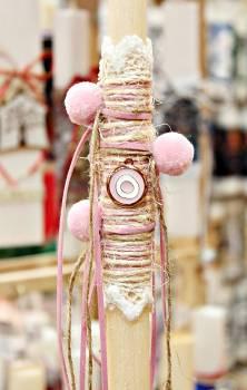 Πασχαλινή λαμπάδα 19068 μπρονζέ ροζ λευκό μάτι σε δερματάκι με λινό κορδόνι Ύψος 25